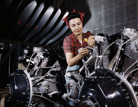 774px-Woman_working_on_an_airplane_motor_at_North_American_Aviation,_Inc.,_plant_in_Calif